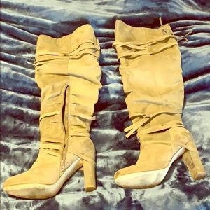 Knee high suede boots.